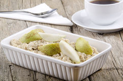 Porridge with sliced pear in a bowl Stock Photo