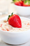 Porridge with strawberries. Royalty Free Stock Images