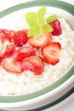 Porridge with strawberries Stock Photos