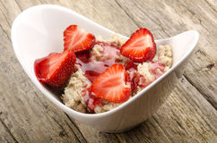 Porridge with strawberry and jam Royalty Free Stock Photography