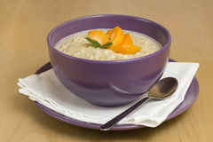 Porridge. Useful breakfast from  with an apricot Stock Photos