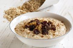Porridge with Walnuts and Raisins. Porridge with walnuts, raisins and brown sugar.  Delicious oatmeal Royalty Free Stock Photo