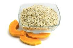 Porridge in ware and a pumpkin Stock Photos