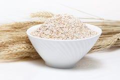 Porridge and Wheat ears Stock Photos
