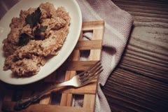 Porridge with wheat germs. Porridge plate, closeup photo of vegetarian food Royalty Free Stock Photos