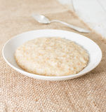 Porridge in white saucer Royalty Free Stock Image