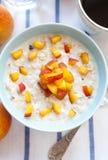Porridge With Peaches Royalty Free Stock Photography