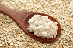 Porridge in a wooden spoon Stock Photography
