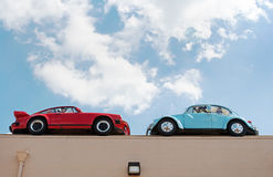 Porsch and Volkswagen on Building Roof Stock Photo