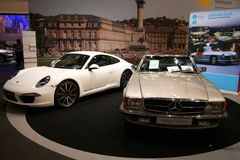 Porsche 911 carrera s and mercedes benz oldtimer Stock Image