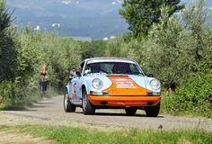Porsche 911 on race. A Porsche 911  driven by Roberto Ermini during the 5th stage of Rally di Reggello in Tuscany (Italy), the rally will take place september Stock Photography