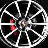 Porsche alloy wheel and emblem. Porsche alloy wheel, break shoe and emblem Royalty Free Stock Photography