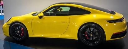 Yellow Porsche 911 Carrera 4S 2019 on 54th Belgrade international car and motor show