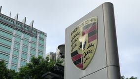 Porsche automobile dealership sign in front of building. In Taipei Taiwan stock footage