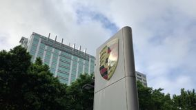 Porsche automobile dealership sign in front of building. In Taipei Taiwan stock video footage