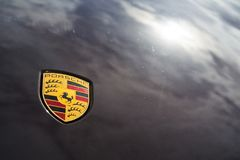 Porsche automotive company logo on car bonnet. PRAGUE, CZECH REPUBLIC - MARCH 29 2018: Porsche automotive company logo on car bonnet on on March 29, 2018 in Stock Photos
