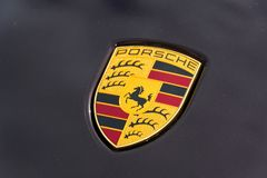 Porsche automotive company logo on car bonnet. PRAGUE, CZECH REPUBLIC - MARCH 29 2018: Porsche automotive company logo on car bonnet on on March 29, 2018 in Stock Photo