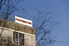 Porsche automotive company logo on Czech headquarters building. PRAGUE, CZECH REPUBLIC - DECEMBER 16: Porsche automotive company logo on Czech headquarters Royalty Free Stock Image