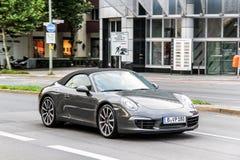 Porsche 991 911. BERLIN, GERMANY - SEPTEMBER 12, 2013: Motor car Porsche 991 911 at the city street Royalty Free Stock Image