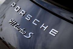 Porsche branding on a classic sports car. Porsche branding, emblems and logos on a vintage Porsche 911 turbo s sports car stock photography