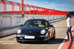 Porsche car on pitlane-aug27 Royalty Free Stock Images