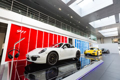 Porsche car for sale. Sport car at car dealership showroom,porsche stock images