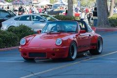 Porsche Carrera bil på skärm royaltyfri foto