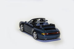 Porsche 911 Carrera Convertible. Back view of a Porsche 911 Carrera Convertible model car isolated Stock Image