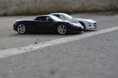 Porsche Carrera GT & Mercedes Benz SLS AMG diecast modeller fotografering för bildbyråer