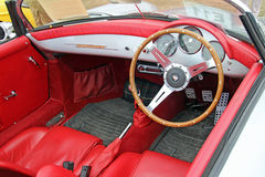 Porsche carrera speedster vintage classic. Photo of a vintage classic porsche carrera speedster convertible interior red leather on show at tankerton slopes Royalty Free Stock Image