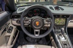 Porsche 911 Carrera sports car interior dashboard. FRANKFURT, GERMANY - SEP 16, 2015: Interior dashboard view Porsche 911 Carrera sports car showcased at the Royalty Free Stock Photo