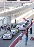 Porsche cars moving to the main track Stock Photography