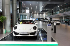 Porsche cars for sale in showroom. Lined up Porsche cars in dealership showroom for sale Royalty Free Stock Images