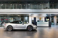 Porsche cars for sale in showroom Royalty Free Stock Photos