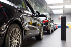Porsche  cars for sale in showroom. Lined up Porsche cars in dealership showroom for sale Stock Photo