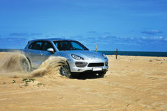 Porsche cayenne on the beach stock photo