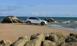 Porsche cayenne on the beach Stock Images