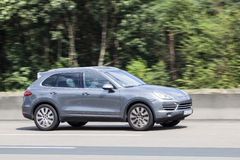 Porsche Cayenne on the road Royalty Free Stock Images