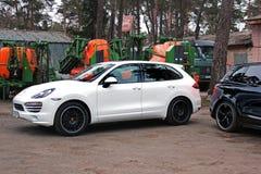 Kiev, Ukraine - 11 April; Porsche Cayenne Turbo TechArt Magnum on background kombine. Porsche Cayenne Turbo TechArt Magnum on background kombine stock images