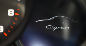 Porsche Cayman. Bucharest, Romania - October 23, 2013:The word Cayman is displayed on the dashboard of a Porsche car. The Porsche Cayman is a sports car produced stock image