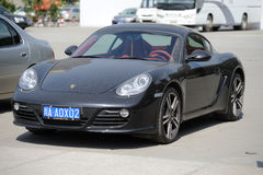 Porsche cayman s in the park. Stock Photos
