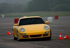 Porsche che guida sulla pista Immagine Stock Libera da Diritti
