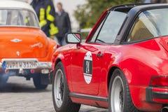 Porsche 911 drives along a street on an oldtimer festival Stock Images
