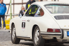 Porsche 911 drives along a street on an oldtimer festival Stock Image