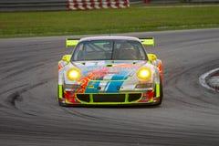 Porsche emballant le chemin de résistance de merdeka Photos stock