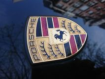 Porsche emblem. Berlin, Germany - April 15, 2018: Porsche sign on a black car. Porsche AG is a German automobile manufacturer specializing in high-performance stock photography