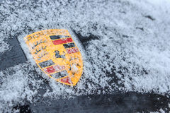 Porsche emblem covered in snow Royalty Free Stock Photos