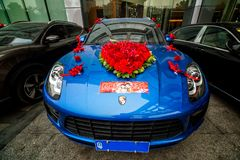 A Porsche 911 is flashy transport for the bride and groom. stock images
