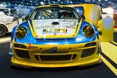 Porsche garnering och ändrar vid den Singha Team On Thailand International Motor expon Royaltyfri Fotografi