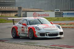 Porsche 911 GT3 Cup at Monza. This Porsche 911 GT3 Cup is driven at Monza in occasion of a Test day organized by Kuno Schaer. Team Fach Auto Tech is developing Royalty Free Stock Photo